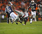 Ole Miss' Ferbia Allen (83) is upended by Auburn defensive back Neiko Thorpe (15) at Jordan-Hare Stadium in Auburn, Ala. on Saturday, October 29, 2011. .