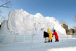Young children look at a sculpture during the Sapporo Snow and Ice Festival in Sapporo City, northern Japan. Around 2 million people visit the city to see the hundreds of hand-crafted snow and ice sculptures that have graced the Sapporo Snow and Ice Festival since its inception in 1950.