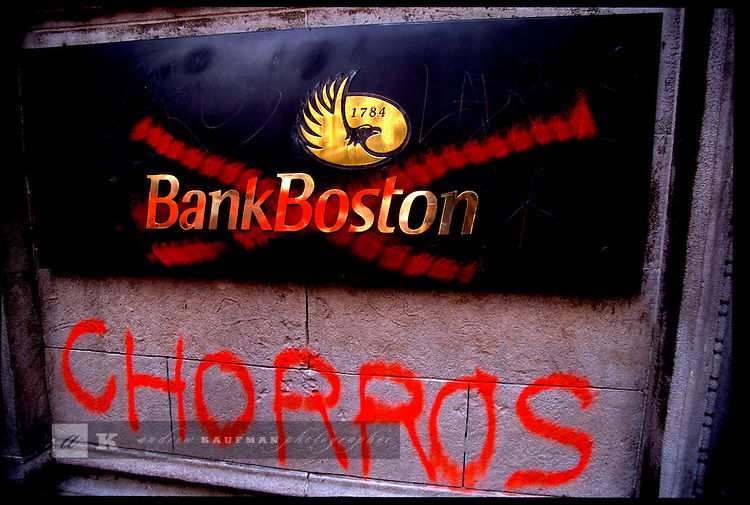 Angry protesters sprayed graffiti on the walls of Bank Boston after the government froze bank accounts in December 2001. Chorros means thieves. It is not a Spanish but a Lunfardo word. Lunfardo is a slang that is used in the Tango lyrics. It was spoken by the immigrants from Italy, Spain and Eastern Europe at the beginning of the century. The immigrants were poor people that lived in San Telmo, La Boca and Barracas neighborhoods of Buenos Aires. Lunfardo helped them to communicate without the authorities knowing what they were talking about.