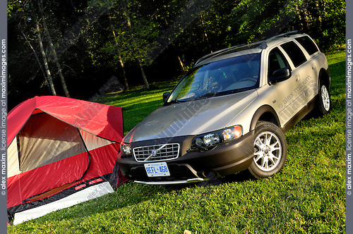 Volvo XC70 car and a camping tent in the nature. Ontario, Canada.