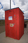 Red wooden outhouse for sale, horseshoe over the door, Como, Colorado