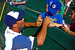 2 July 2011: Vermont Lake Monsters' infielder Sean Jamieson signs an autograph for a Little Leaguer prior to a game against the Tri-City ValleyCats at Centennial Field in Burlington, Vermont. The Lake Monsters rallied from a 4-2 deficit to defeat the ValletCats 7-4 in NY Penn League action. Mandatory Credit: Ed Wolfstein Photo