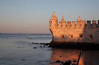 Bastion terrace with Moorish bartizan turrets and cannon holes at the Torre de Belem or Belem Tower, built in the 16th century by Francisco de Arruda under King John II as part of a defence system at the mouth of the river Tagus and a ceremonial gateway to the city, Santa Maria de Belem, Lisbon, Portugal. The limestone tower is built in Late Gothic Manueline style, and consists of a bastion and 4 storey tower. It is listed as a UNESCO World Heritage Site due to its important role during the Portuguese Age of Discoveries. Picture by Manuel Cohen