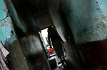INDIA (West Bengal - Calcutta) -A sex worker passes through a narrow lane in a red light area in Kolkata, India- Arindam Mukherjee