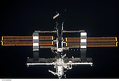 In Earth Orbit - July 6, 2006 -- The International Space Station is backdropped against the darkness of space in this digital image, recorded by the astronaut crewmembers onboard Space Shuttle Discovery. A little later, the shuttle and the orbital outpost linked up for what will be more than a week of joint activities for their respective crews..Credit: NASA via CNP
