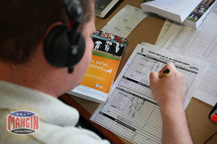 SCOTTSDALE, AZ - MARCH 19:  Radio broadcaster Doug Greenwald announces a spring training game between the Chicago White Sox and San Francisco Giants in the press box at Scottsdale Stadium in Scottsdale, Arizona on March 19, 2009.  Photo by Brad Mangin