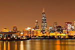 Chicago Illinois downtown at night lakefront city skyline with Willis Tower (Sears Tower) and Shedd Aquarium.