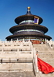 Young bride in red wedding dress in front of The Temple of Heaven, Hall of Prayer in Beijing, China 2014