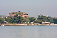 Myanmar, Burma.  Mingun Paya, near Mandalay.  Begun in 1790, this is the base of a pagoda planned to be 500 feet tall.  Construction ended in 1819 when King Bodawpaya died.  Size is indicated by the people standing on top.