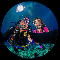 """27 July 2015: SCUBA Divers Sally Herschorn and Ed Wolfstein pose for an underwater """"selfie"""" self-portrait at School House Reef, on the North side of Grand Cayman Island. Located in the British West Indies in the Caribbean, the Cayman Islands are renowned for excellent scuba diving, snorkeling, beaches and banking.  Mandatory Credit: Ed Wolfstein Photo *** RAW (NEF) Image File Available ***"""