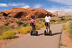 Couple on a Segway at Snow Canyon State Park, Utah, UT, scenic, landscape, Segways, Segway riders, model released, rock formations, landforms, arid, Southwest America, American Southwest, US, United States, Image ut409-18584, Photo copyright: Lee Foster, www.fostertravel.com, lee@fostertravel.com, 510-549-2202