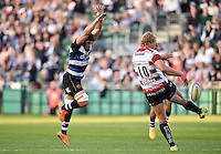 Guy Mercer of Bath Rugby looks to charge down a kick from Billy Twelvetrees of Gloucester Rugby. West Country Challenge Cup match, between Bath Rugby and Gloucester Rugby on September 26, 2015 at the Recreation Ground in Bath, England. Photo by: Patrick Khachfe / Onside Images