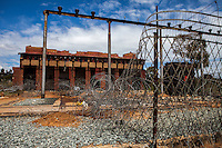 Durban Deep's gutted substation days after its was stripped for its valuable copper and metal. Like many of South Africa's now defunct gold mines, Durban Deep is a relic from South Africa's apartheid past.  It sits on Johannesburg's West Rand flanked by the distinctive glimmering hills of gold dust and its rusting headgear rising up majestically.  While Durban Deep shut down its mining operations almost 15 years ago, the property it sits on has continued as a neighborhood to many low income residents who moved in after miners and management left.