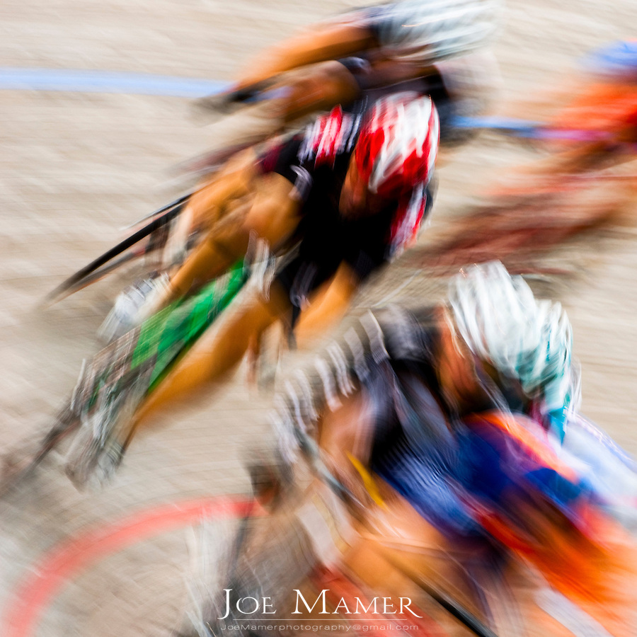 Abstract image of cyclists racing at the velodrome.