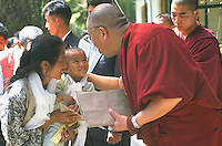 Tibetans & westerners in audience with the Dalai Lama at his compound.