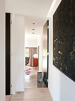 The black and white colour scheme is carried from the hall into the guest bedroom giving a sense of continuity and flow