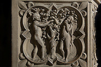 Detail of bas-relief sculpture, mid 13th century, on the base of the portal of the Upper chapel of La Sainte-Chapelle, Paris, France. One of a series of reliefs illustrating scenes from the Old Testament book of Genesis. Here we see Adam and Eve tasting the fruit of the Tree of Knowledge. Each panel has a decorated curly frame. Sainte Chapelle was built 1239-48 to house King Louis IX's collection of Holy Relics. It is a UNESCO World Heritage Site. Picture by Manuel Cohen.