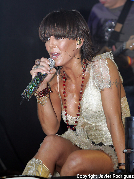 """Mexican singer Alejandra Guzman sings a song of her new album """"Indeleble"""" (Indelible) during a concert at the Mexico City's Hard Rock Cafe, March 30, 2006. Photo by © Javier Rodriguez"""