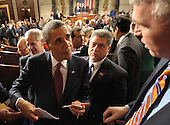 United States President Barack Obama signs autographs following his State of the Union address to a joint session of Congress, Tuesday, January 24, 2012 at the Capitol in Washington, DC. .Credit: Saul Loeb / Pool via CNP