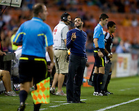 DC United head coach Ben Olsen speaks with referee's assistant George Gasner during their game at RFK Stadium in Washington, DC.  Houston defeated D.C. United, 3-1.
