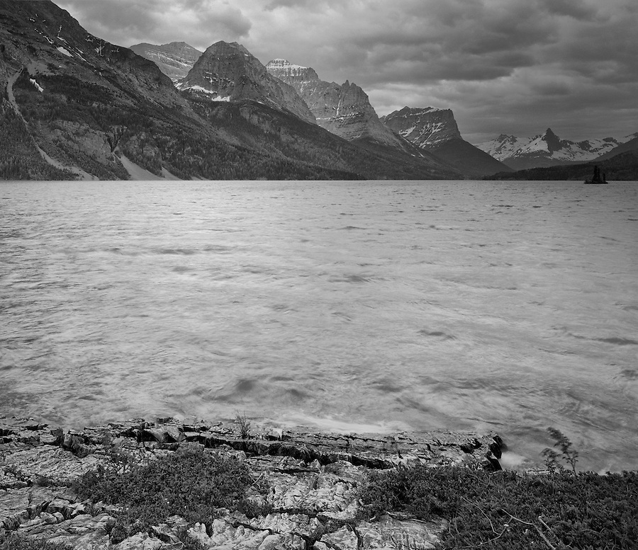 High winds blow waves into the shore long St. Mary Lake in Glacier National Park, Montana.