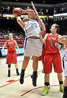 gbs030912r/SPORTS/Greg Sorber --  Elida's Kaylen Jasso, 23, shoots between Corona's Saige Bell, 14, and Taylor Huey, 15, during the B Girls State Championship in the Pit on Friday, March 9, 2012. Elida overcame Corona 59-41.