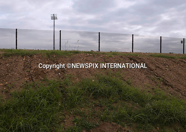 """EXCLUSIVE!! .Must telephone +441279 324672 for reproduction fees and usage..FORTIFIED WORLD CUP 2010 STADIUMS.To protect the visiting teams while training at the Gelvandale Stadium, Port Elizabeth, it has been fortified with and outer wall topped with barbed wire and inner fence on a raised 20ft mound..Crime and poverty are rife in the area bordering the football stadiums where the matches will be played..Teams and fans from England, Germany, Portugal, Cote d'Ivoire, Switzerland, Serbia, Slovenia, Chile, Korea and Greece will descend on the area during the World Cup 2010..Mandatory Credit Photos: ©Newspix International..**ALL FEES PAYABLE TO: """"NEWSPIX INTERNATIONAL""""**..PHOTO CREDIT MANDATORY!!: NEWSPIX INTERNATIONAL(Failure to credit will incur a surcharge of 100% of reproduction fees)..IMMEDIATE CONFIRMATION OF USAGE REQUIRED:.Newspix International, 31 Chinnery Hill, Bishop's Stortford, ENGLAND CM23 3PS.Tel:+441279 324672  ; Fax: +441279656877.Mobile:  0777568 1153.e-mail: info@newspixinternational.co.uk"""