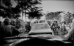 Rural traffic jam on a crowded little island, Bali, Indonesia.  As Bali's population grows, the spread of towns and cities, including traffic jams, infiltrates formerly rural districts.