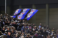 A Bath fan in the crowd waves a giant flag in support. Aviva Premiership match, between Bath Rugby and Northampton Saints on September 14, 2012 at the Recreation Ground in Bath, England. Photo by: Patrick Khachfe / Onside Images
