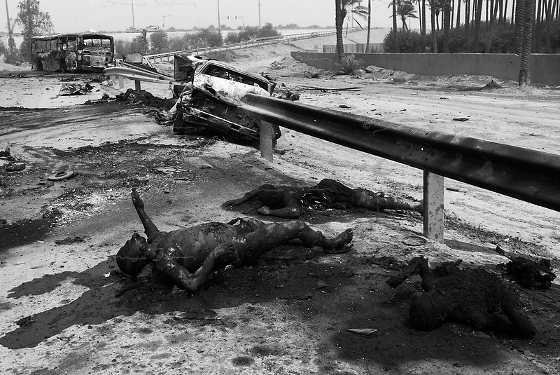 Baghdad, Iraq, April 9, 2003.Jamieh, southern outskirts of Baghdad, torn vehicles and charred bodies on the Hilla road bear witness of the violence of the fight for the city.