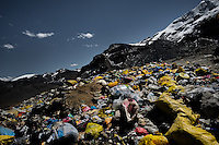 Garbage seen piled up along the paths in La Rinconada, Peru, 4 August 2012. During the last decade, the rising price of the gold has attracted thousands of people to La Rinconada in the Peruvian Andes. At 5300 metres above sea level, nearly 50.000 people work in the gold mines and live in the nearby colonies without running water, sewage system or heating service. Although the work in the mines is very dangerous (falling rocks, poisonous gases and a shifting glacier), the majority of miners have no contract and operate under the cachorreo system - working 30 days without payment and taking the gold they supposedly find the 31st day as the only salary. In spite of a demaged environment, caused by mercury contamination from the mining and the lack of garbage disposal, people continue to flock to the region hoping to find their fortune.