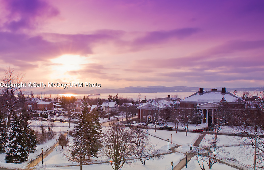 Winter sunset over Waterman,  the UVM Campus Green, Burlington and Lake Champlain. Winter UVM Campus