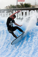Collegiate Nationals, San Diego, CA.  Saturday, April 19 2008.  A member of the Point Loma Nazarene University (PLNU) team competes in the semi-finals of the Flowboarding competiion at the Wave House in Mission Beach.  PLNU's Chris Neubauer took the $1500 first prize in the final.