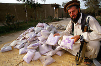 A soldier of the Northern Alliance commander, Qasir Kabir, has two hundred kilograms of heroin worth $800,000 he says he must burn and destroy in the name of Allah.