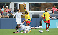 Bryon Bubb (7) brings down Kyle Beckerman (5). USA defeated Grenada 4-0 during the First Round of the 2009 CONCACAF Gold Cup at Qwest Field in Seattle, Washington on July 4, 2009.