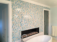 Climbing Vines, a jewel glass water jet mosaic, is shown with Aquamarine leaves and Quartz vines.<br />