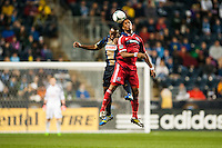 Sherjill MacDonald (7) of the Chicago Fire goes up for a header with Amobi Okugo (14) of the Philadelphia Union. The Philadelphia Union defeated the Chicago Fire 1-0 during a Major League Soccer (MLS) match at PPL Park in Chester, PA, on May 18, 2013.