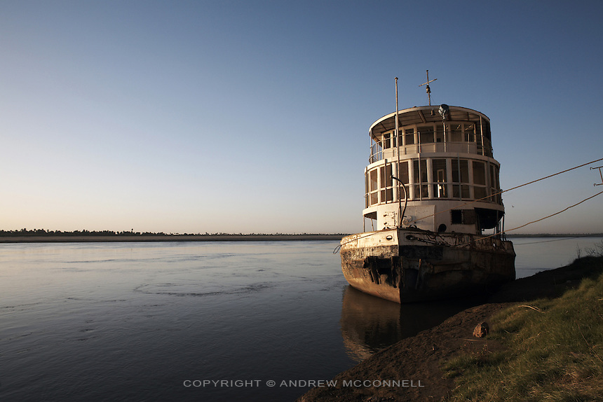 A former Nile steamer that once served the route between Karima and Dongola is left to decay on the banks of the Nile at Karima, Sudan, on Wednesday, March 28, 2007.