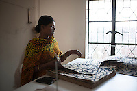 Rupali Begum, 25, survived the collapse of Rana Plaza on April 24, 2013. Rupali and another four survivors now work in a model garment factory called 'Oporajeo', a worker-owned factory in Savar, near Dhaka, Bangladesh