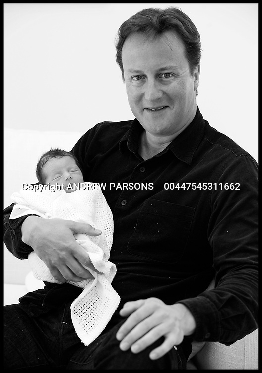 Prime Minister David Cameron holds his baby daughter, Florence Rose Endellion Cameron who was born on Tuesday August 24, during their summer holiday in Cornwall, Saturday August 28, 2010, Photo By Andrew Parsons
