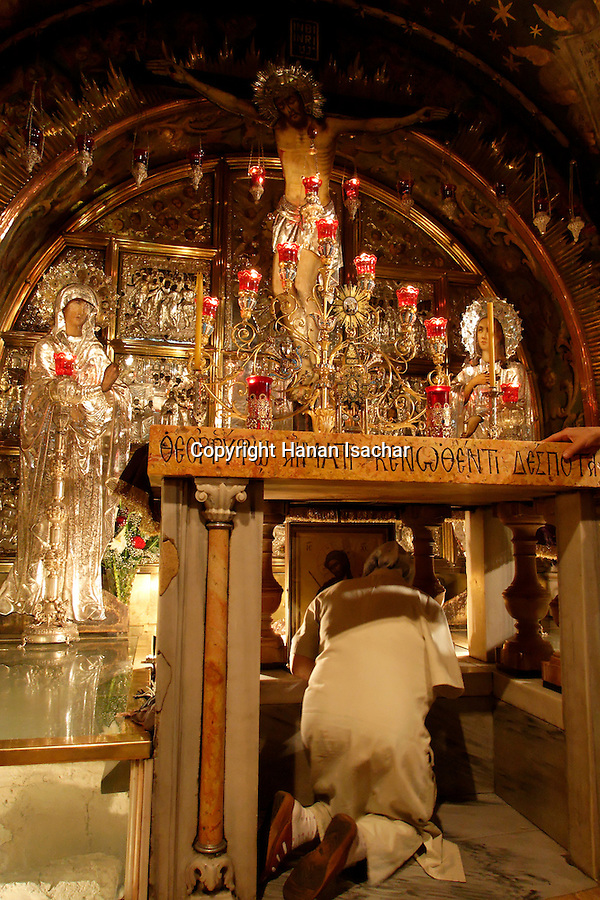 Israel, Jerusalem Old City. The 12th Station of the Via Dolorosa at the Church of the Holy Sepulchre, the place of the Crucifixion, Golgotha in Aramic. Calvary in Latin. 2006<br />