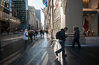 Pedestrians at the corner of Fifth Avenue and West 57th Street on Thursday, January 23, 2014. (© Richard B. Levine)