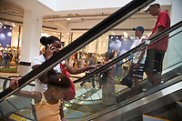 New Brazilian medium-class at Nova America Shopping Center, located in a former  destitute Rio de Janeiro quarter. During president Lula government ( 2003 - 2010 ) a new class of consumers was created in Brazil.