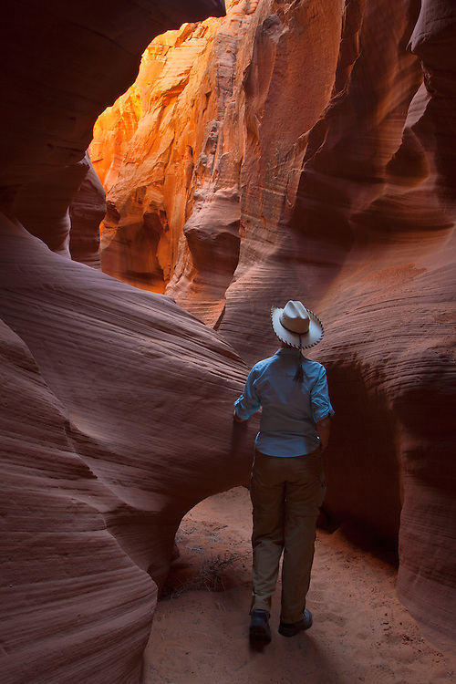 Jacque Miniuk walks through Secret Canyon near Page, Arizona (model release available)