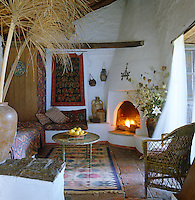 A Moroccan style sitting room in a white-washed cottage