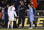 11 December 2009: Referee Alex Prus tosses the coin before the games for Akron's Ben Zemanski (13) and UNC's Zach Loyd (right). The University of Akron Zips defeated the University of North Carolina Tar Heels 5-4 on penalty kicks after the game ended in a 0-0 overtime tie at WakeMed Soccer Stadium in Cary, North Carolina in an NCAA Division I Men's College Cup Semifinal game.