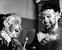 Celebrating after 1972 World Series victory, Joe Garagiola and Reggie Jackson in the A's dressing room  with shaving cream faces following the game.<br />(photo/Riesterer)