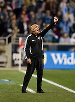 Houston Dynamo head coach Dominic Kinnear yells to his team from the sideline during the game at PPL Park in Chester, PA.  Houston defeated Philadelphia, 2-1, to take home the one goal advantage in the home and home series..