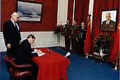 United States President Ronald Reagan signs a condolence book for the late leader of the Soviet Union, Konstantin Chernenko, as Ambassador Anatoly Fyodorovich Dobrynin of the Soviet Union looks on.  The President visited the Soviet Embassy in Washington, D.C. on Monday, March 11, 1985..Mandatory Credit: Michael Evans - White House via CNP
