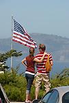 Couple & US flag near Coit Tower